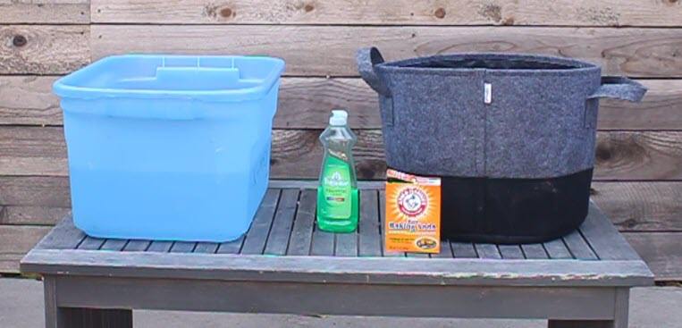 Fabric grow bags can easily be washed in a plastic storage tub.